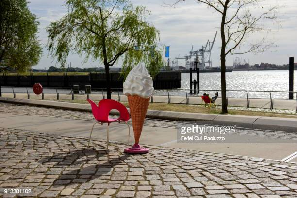 A red chair and an Ice cream cone model at Hamburg, Germany