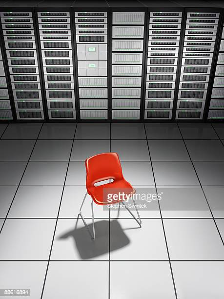 A red chair in a network server room