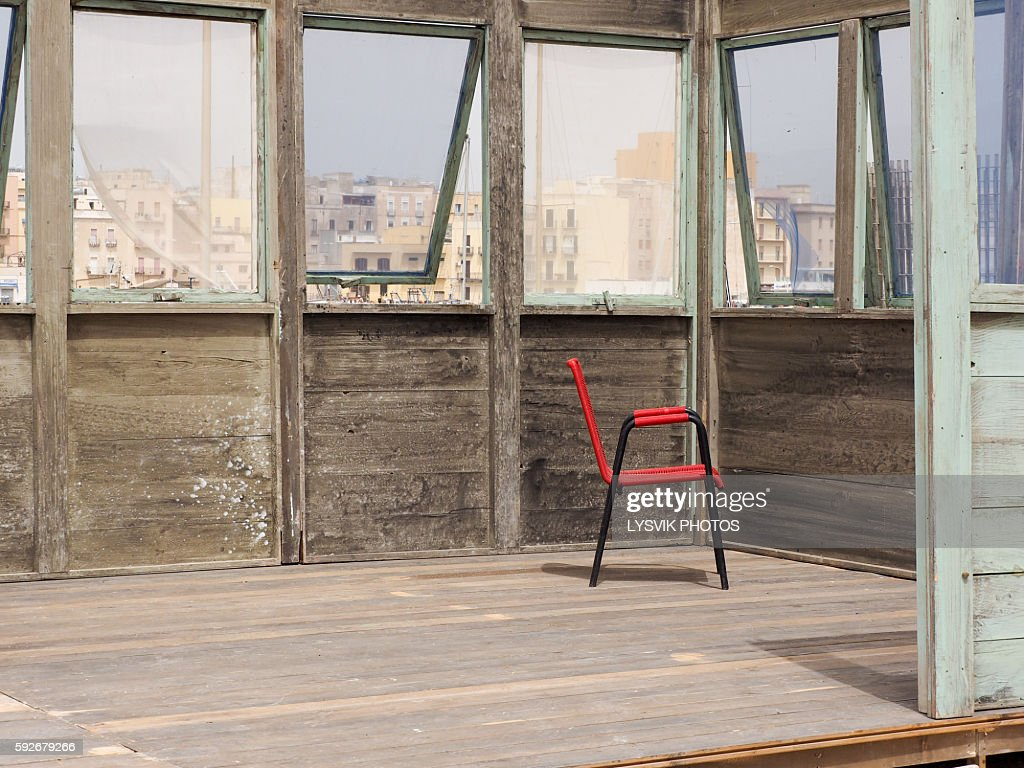 Red chair in wooden building : Stock Photo