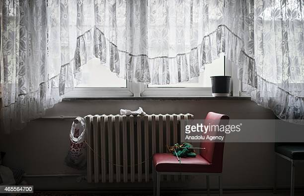 A red chair with knitting on is seen at a women's shelter on International Women's Day in Ankara Turkey on March 8 2015 Women staying in a women's...