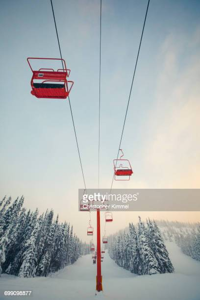 red chairlift at manning park ski resort, british columbia, canada. - ski lift stock pictures, royalty-free photos & images