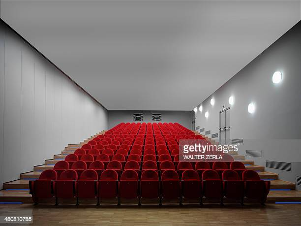 red chairs in empty auditorium - auditorium stock pictures, royalty-free photos & images