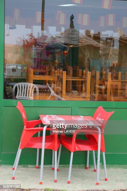 Red chairs in front of a restaurant on Fuerteventura