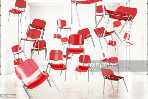 red chairs in the air - man made object stock pictures, royalty-free photos & images