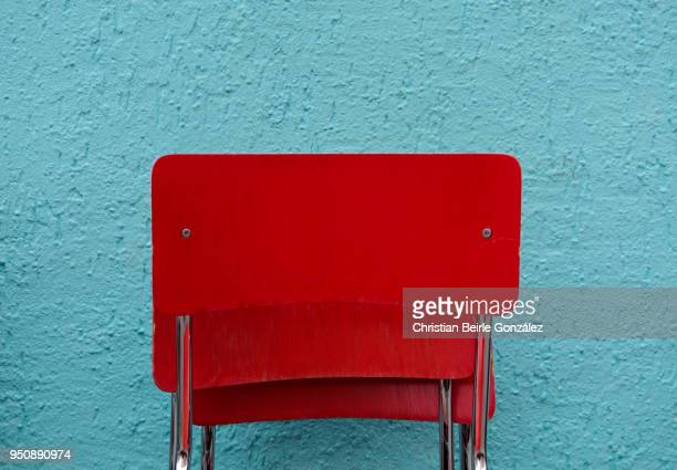 red chairs - christian beirle stockfoto's en -beelden