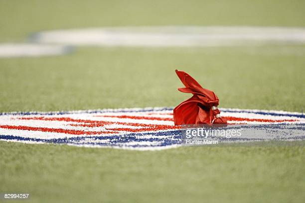 A red challenge flag rests on the field after being thrown during a game between the Dallas Cowboys and the Philadelphia Eagles on September 15 2008...