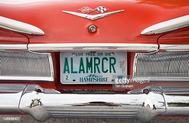 Red Chevrolet Impala convertible automobile registration plate Anna Maria Island Florida USA