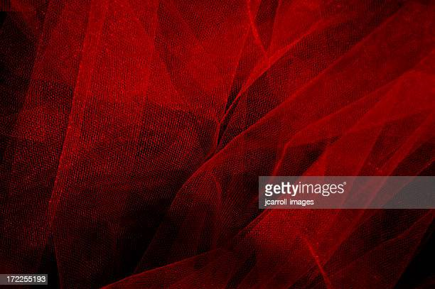 Red chiffon on a black background