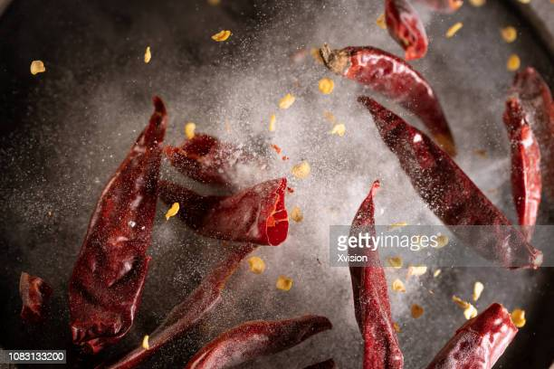 red chili pepper in high speed photographer - spice stock pictures, royalty-free photos & images