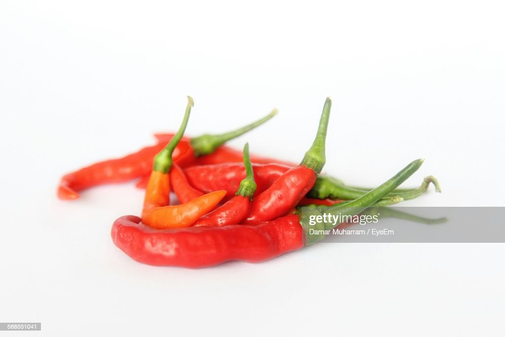 Red Chili Peppers Against White Background : Stock Photo