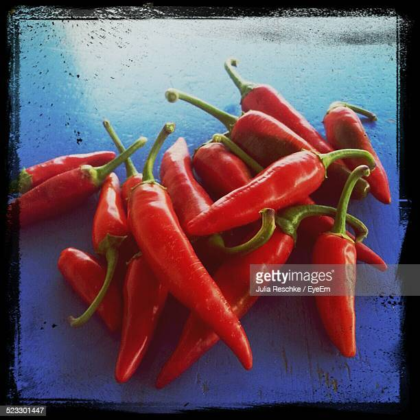 Red Chili Peppers On Blue Surface