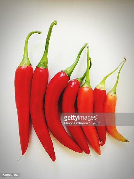 Red Chili Peppers On Gray Background