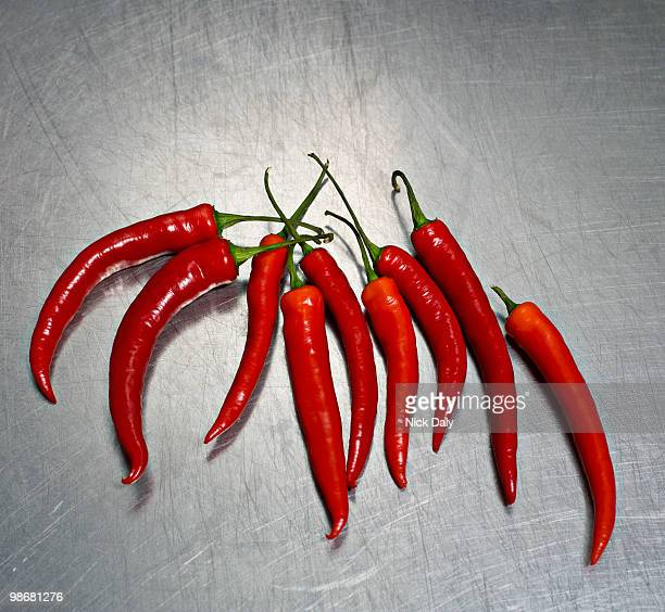 Red chilies on a steel surface