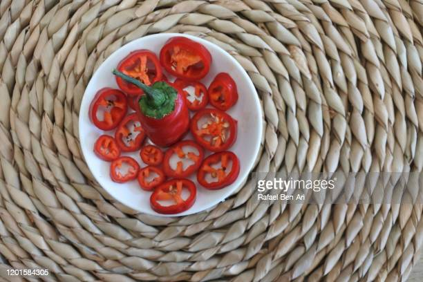 red chilli pepper slices served in a plate on a woven mat - rafael ben ari stock pictures, royalty-free photos & images