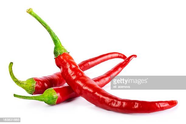red chilli peppers isolated on white - chili stock photos and pictures