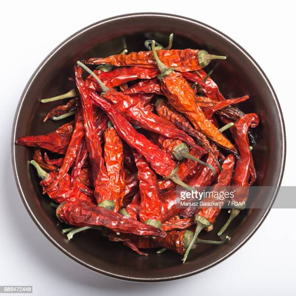 Red chilli peppers on bowl
