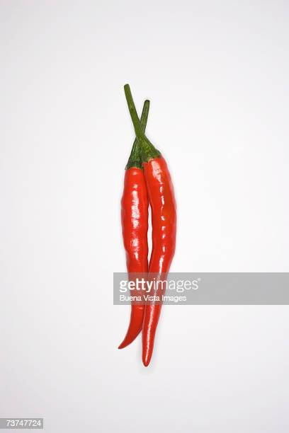 Red chillies pepper against white background, close-up