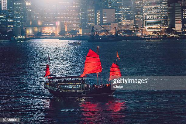 Red Chinese junkboat touring in Victoria Harbour