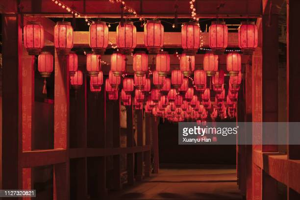 red chinese lantern decorations for chinese new year. - gala stock pictures, royalty-free photos & images