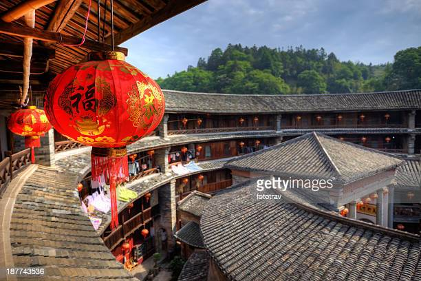 red chinese lantern in a hakka tulou traditional housing, fujian - fujian tulou stock pictures, royalty-free photos & images