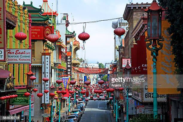 Red Chinese lanterns hanging in Grant Avenue in the Chinatown district of San Francisco California US