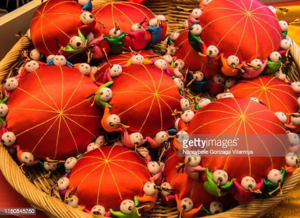 red chinese pin cushions - nancybelle villarroya stock photos and pictures
