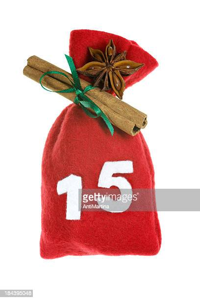 red christmas bag for advent calendar isolated on white - advent calendar stock photos and pictures