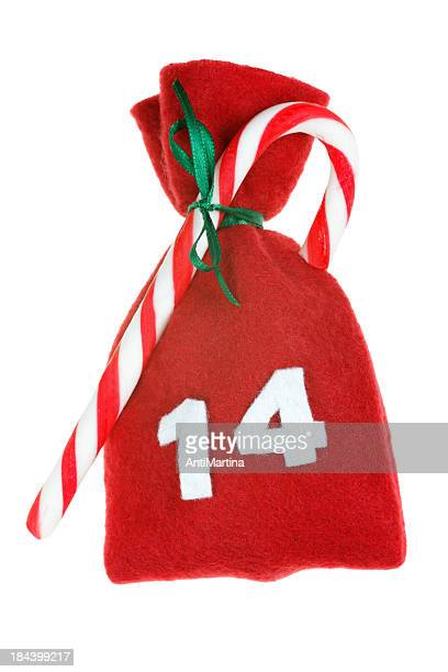 red christmas bag for advent calendar isolated on white - number 14 stock photos and pictures