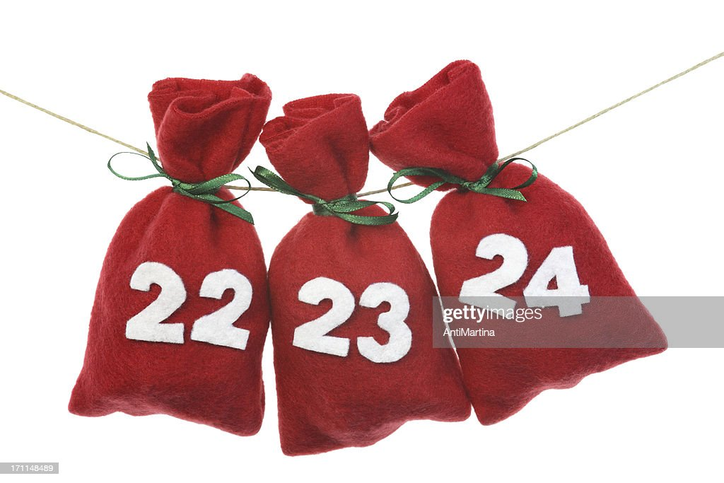 red Christmas bags for advent calendar on a string : Stock Photo