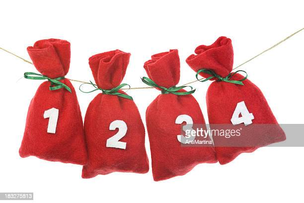 red Christmas bags for advent calendar on a string