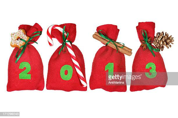 red Christmas bags (year 2013) isolated on white