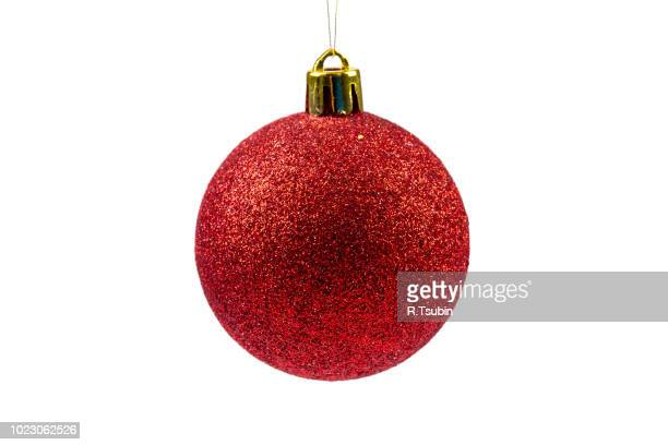 red christmas ball isolated on white background - christmas ornaments stock photos and pictures