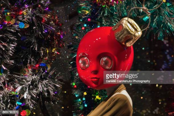 red christmas ball man - man with big balls stock photos and pictures