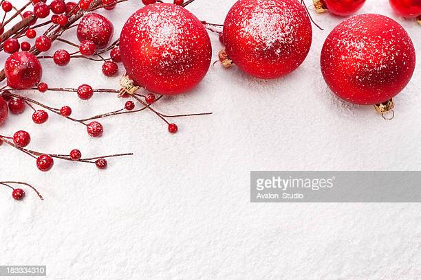 Red Christmas balls on the snow. Christmas decoration.