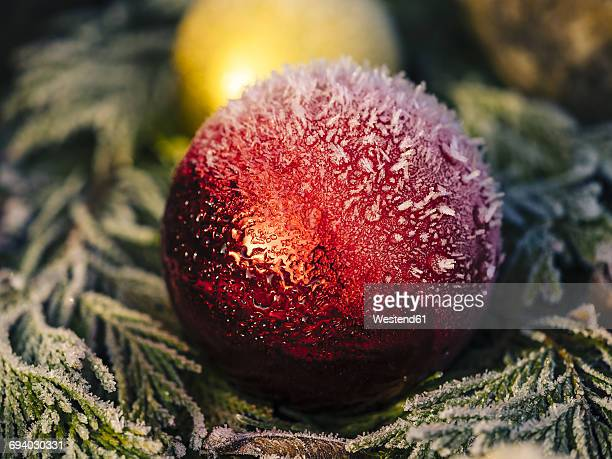 Red christmas bauble with snow