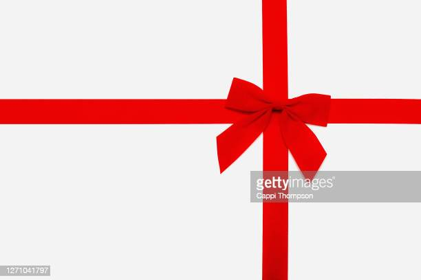 red christmas bow isolated over white background - bow tie stock pictures, royalty-free photos & images