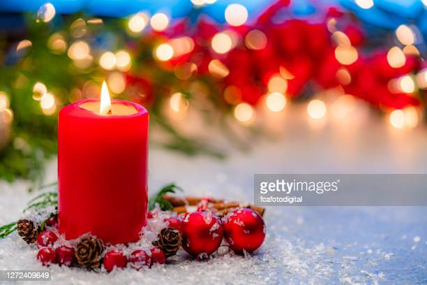 red christmas candle. copy space - christmas decore candle stock pictures, royalty-free photos & images