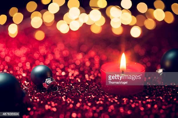 Rot Weihnachten-Kerze Licht Dekoration Gold Bokeh Unscharf gestellt