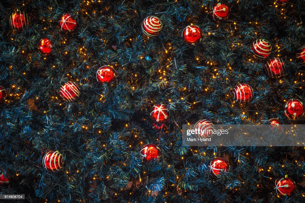 Red christmas decorations on christmas tree : Stock Photo