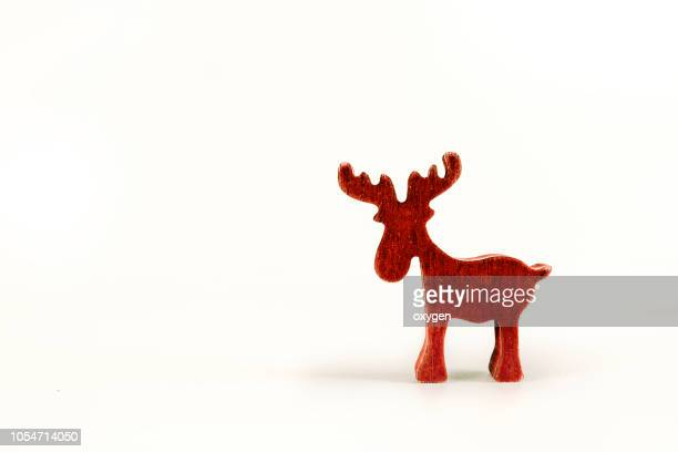 red christmas elk isolated on white background - country christmas stock pictures, royalty-free photos & images
