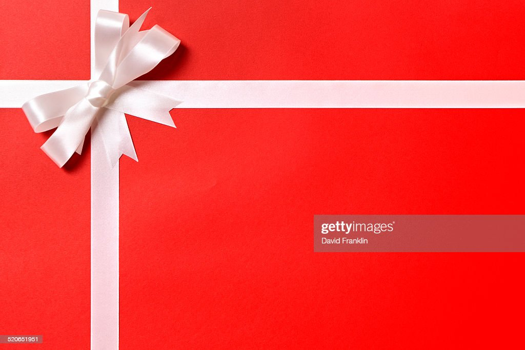 Red christmas gift background with white ribbon stock photo getty red christmas gift background with white ribbon stock photo negle Gallery