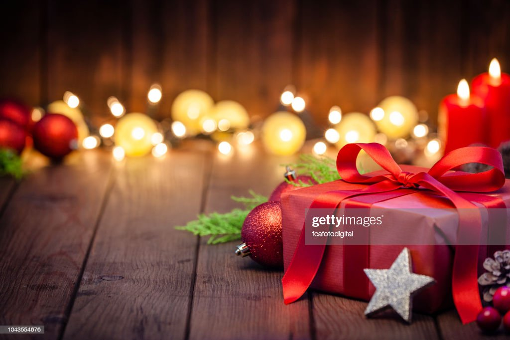 Red Christmas gift box on rustic wooden table : Stock Photo
