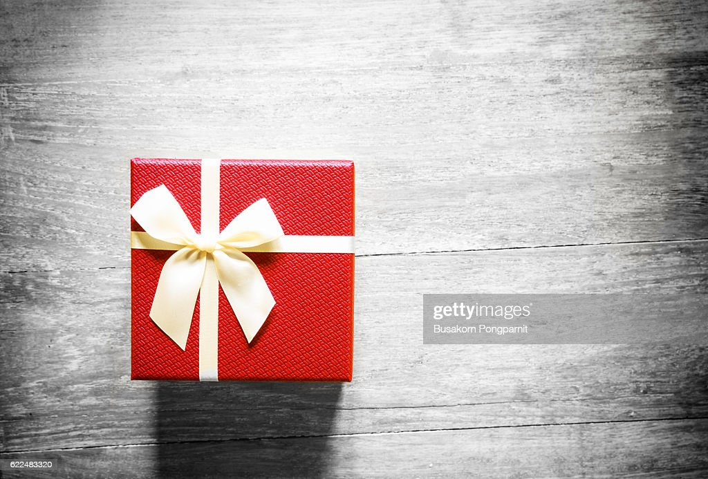 Red christmas gift box on wooden table : Stock Photo