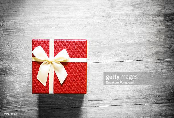 Red christmas gift box on wooden table