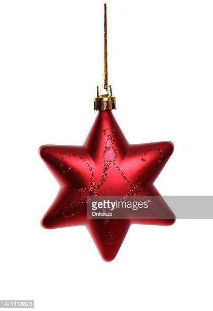red christmas star isolated on white background - christmas star stock photos and pictures
