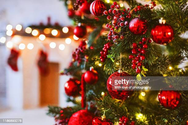 red christmas tree and fireplace decoration, merry christmas and happy new year, red and white christmas decor design, christmas background - christmas decoration stock pictures, royalty-free photos & images
