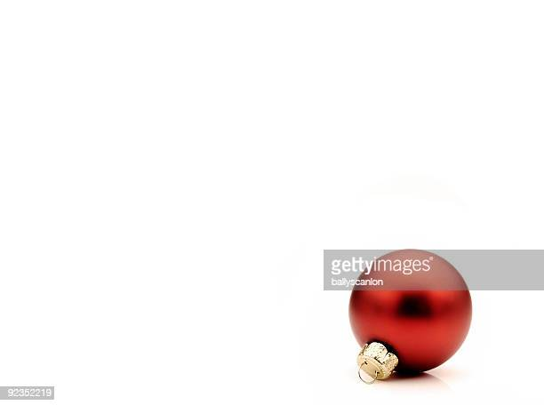 red christmas tree bauble on a white background. - christmas background stock photos and pictures