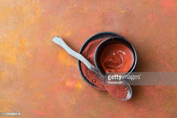 red clay on spoon and plate and stirred in a bowl - clay stock pictures, royalty-free photos & images