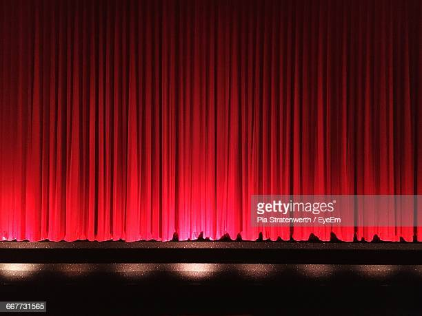 red closed curtains on stage - stage curtain stock pictures, royalty-free photos & images