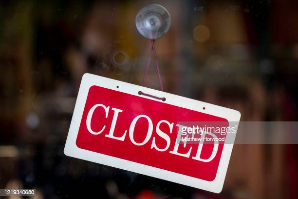 A red closed sign hanging in the window of a small business on April 15 2020 in Cardiff United Kingdom In a press conference on Thursday First...